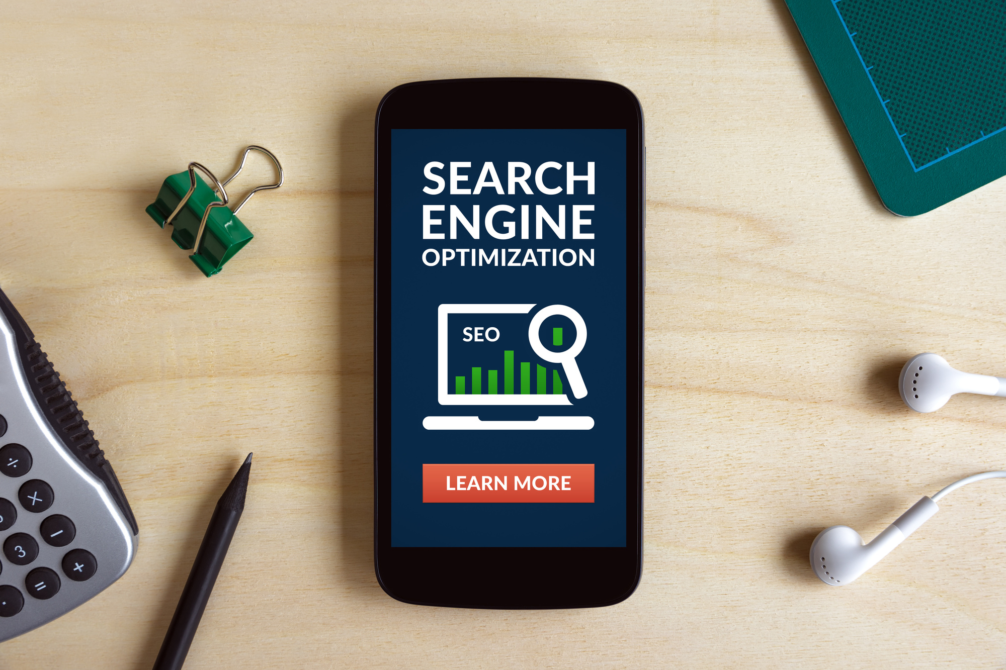 a phone on a desk highlighting search engine optimization and education