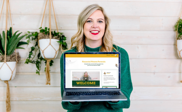 Jamie Trull holding a computer with Financial Fitness Formula welcome screen