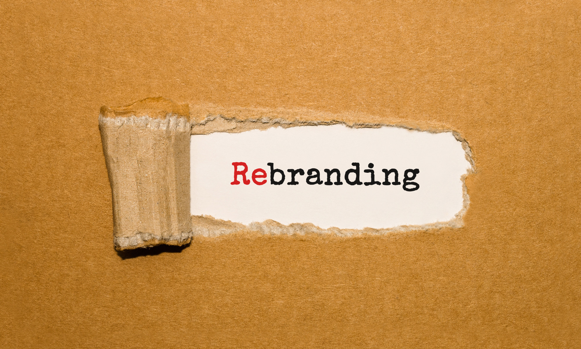 an image of the word rebranding being revealed but note there is a lot to consider before you rebrand